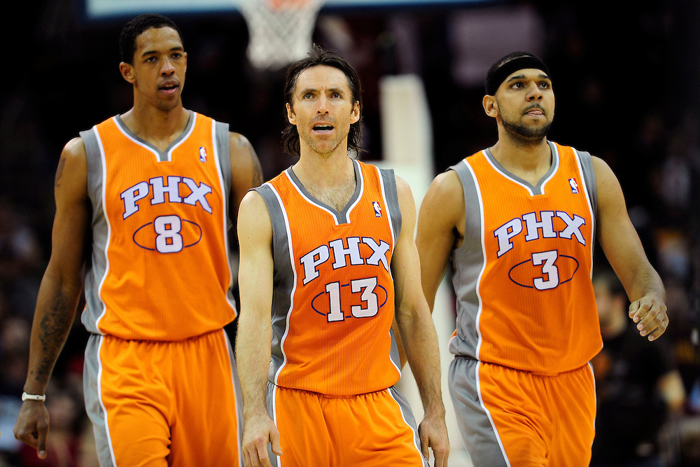Jan. 19, 2011; Cleveland, OH, USA; Phoenix Suns center Channing Frye (8) point guard Steve Nash (13) and small forward Jared Dudley (3) walk down court during the third quarter at Quicken Loans Arena. The Suns beat the Cavaliers 106-98. Mandatory Credit: Jason Miller-US PRESSWIRE