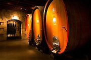 Oak wine casks in wine cellar in Napa Valley winery, California.