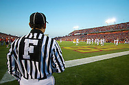 A football official keeps an eye on the action on the field in Ames, Iowa as Texas A&M plays at Iowa State University on Oct. 25, 2008.