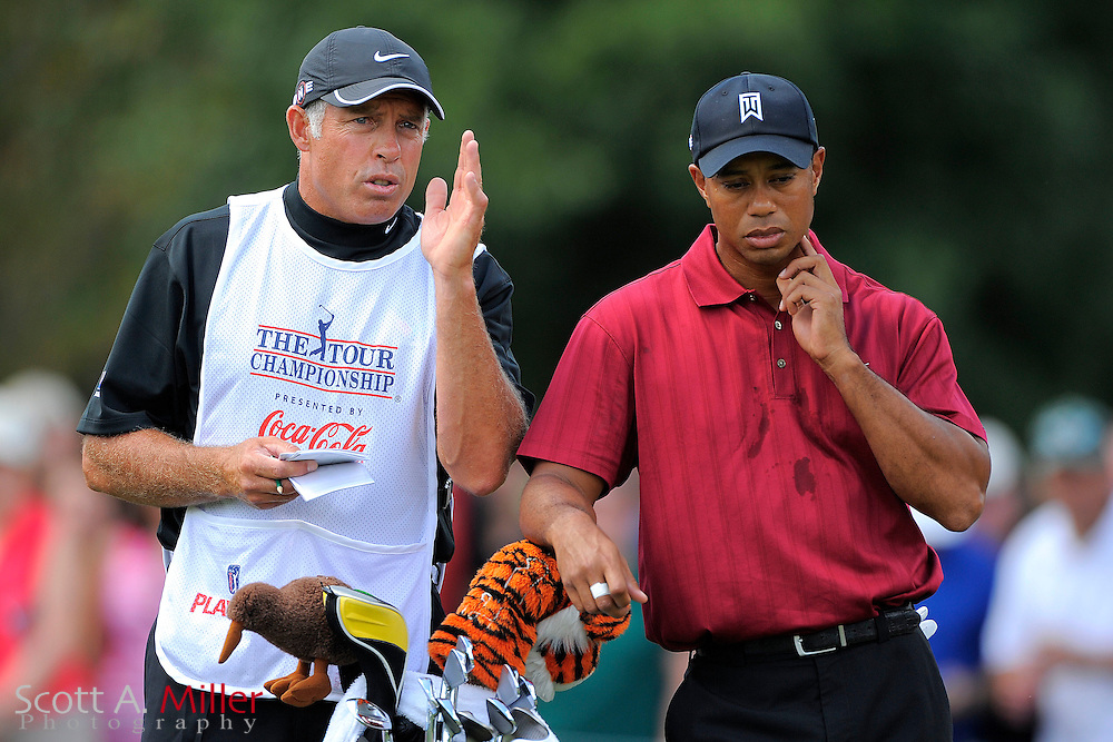 Tiger Woods (USA) talks with his caddie Steve Williams on the second hole during the final round of the PGA Tour Championship the final event of the 2009 FedEx Cup at East Lake Golf Club on Sept. 27, 2009 in Decatur, Ga.     ..©2009 Scott A. Miller