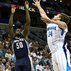 April 1, 2011; New Orleans, LA, USA; Memphis Grizzlies power forward Zach Randolph (50) shoots over New Orleans Hornets center Aaron Gray (34) during the first quarter at the New Orleans Arena.    Mandatory Credit: Derick E. Hingle