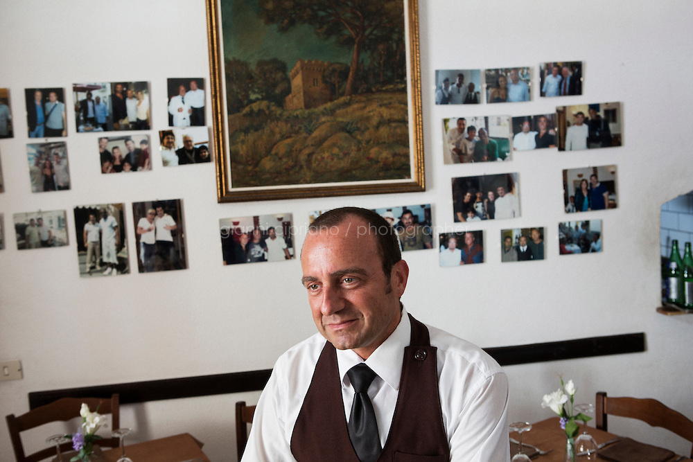 ANACAPRI, ITALY - 22 JULY 2014: Peppe Marino, a waiter who lived in Brooklyn and and met Mayor of New York Bill De Blasio during his visit to Capri, poses for a portrait at the Pizzeria Materita where he works, in Anacapri, a small comune on the island of Capri, Italy, on July 22nd 2014. Peppe Marino<br /> <br /> New York City Mayor Bill de Blasio arrived in Italy with his family Sunday morning for an 8-day summer vacation that includes meetings with government officials and sightseeing in his ancestral homeland.