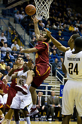 January 9, 2010; Berkeley, CA, USA;  Southern California Trojans guard Mike Gerrity (44) shoots in front of California Golden Bears center Markhuri Sanders-Frison (45) during the second half at the Haas Pavilion.  California defeated USC 67-59.
