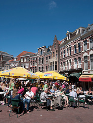 Busy outdoor summer cafes in central Utrecht in the Netherlands