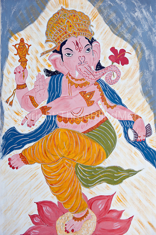 Dancing Ganesh painted on wall of a Hindu shrine on the beach at Anse La Raie.