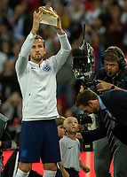Football - 2018 / 2019 UEFA Nations League A - Group Four: England vs. Spain<br /> <br /> Harry Kane (England) shows off his Golden Boot from the World Cup 2018 as his young mascot looks on upwards at Wembley Stadium.<br /> <br /> COLORSPORT/DANIEL BEARHAM