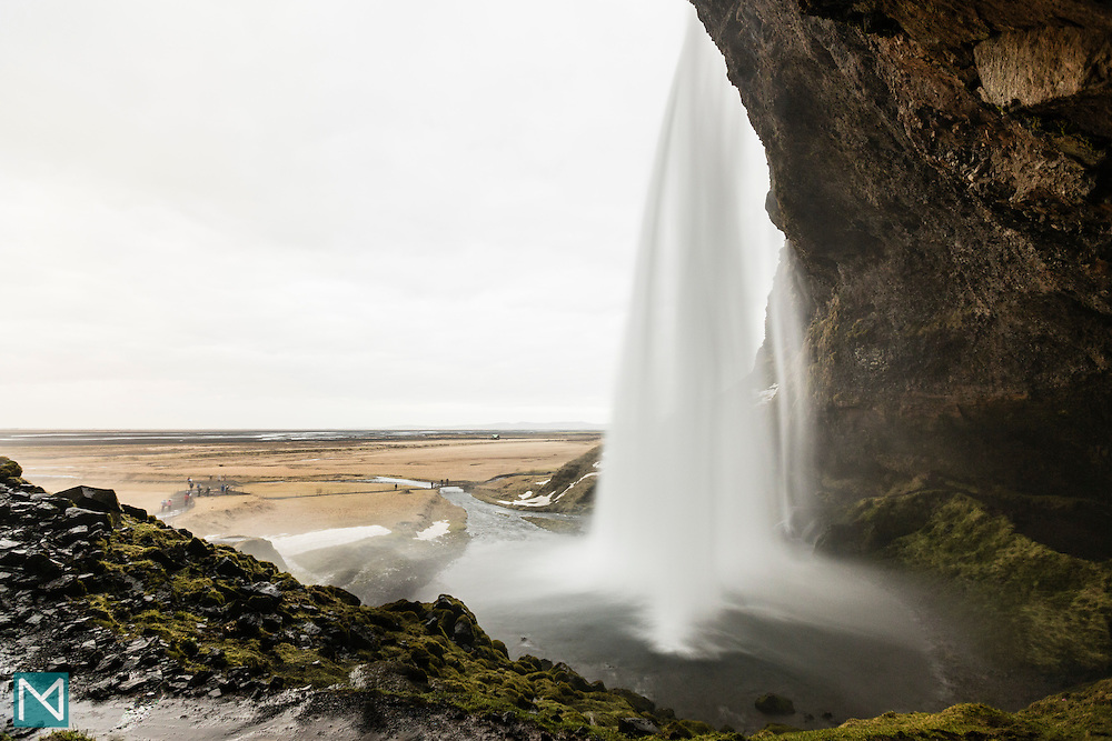 Seljalandsfoss waterfall in southern Iceland, viewed from behind