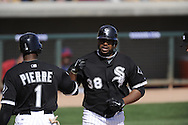 GLENDALE, AZ - MARCH 07:  Stefan Gartrell #38 is greeted by Omar Vizquel #11 of the Chicago White Sox after scoring against the Cleveland Indians on March 07, 2011 at The Ballpark at Camelback Ranch in Glendale, Arizona. The game ended in a 16-16 tie. (Photo by Ron Vesely)