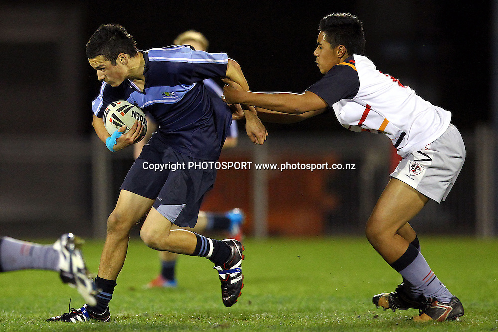 Whangaparaoa's Laurence Tousoon is caught by Glenfield's Heinrich Brahne. NZRL Under 85kg Secondary Schools Rugby League match, Whangaparaoa College v Glenfield College at Mt Smart Stadium, Auckland, New Zealand. Monday 10th September 2012. Photo: Anthony Au-Yeung / photosport.co.nz