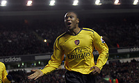 Photo: Paul Thomas.<br /> Liverpool v Arsenal. Carling Cup. 09/01/2007.<br /> <br /> Arsenal's Julio Baptista scores and celebrates his third goal of the night.