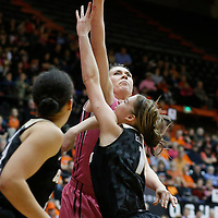 Oregon State's Ruth Hamblin, center rear, blocks the shot of Colorado's Makenzie Ellis, center front, in the first half of an NCAA college basketball game in Corvallis, Ore., on Friday, Feb. 12, 2016. (AP Photo/Timothy J. Gonzalez)