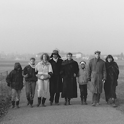Family on a winter walk.<br /> (Analog black and white image. Scan from manually developed negative.)<br /> <br /> (Early summer 2015) Recent remake of the scene. Approximately 26 years later.<br /> Same photographer, recent iPhone camera, same protagonists including offspring! - Hat still looks good on certain people!<br /> <br /> Follow link to Facebook post: https://www.facebook.com/andreas.muller.144/posts/966588063372512