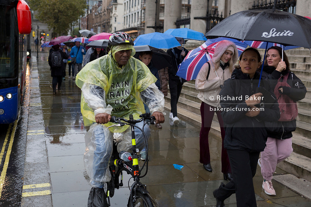 Londoners and visitors to the capital endure heavy rainfall on an autumn afternoon in Trafalgar Square, on 24th October 2019, in Westminster, London, England.