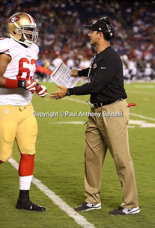 San Francisco 49ers head coach Jim Harbaugh congratulates players as they come off the field during the NFL week 4 preseason football game against the San Diego Chargers on Thursday, Aug. 29, 2013 in San Diego. The 49ers won the game 41-6. ©Paul Anthony Spinelli