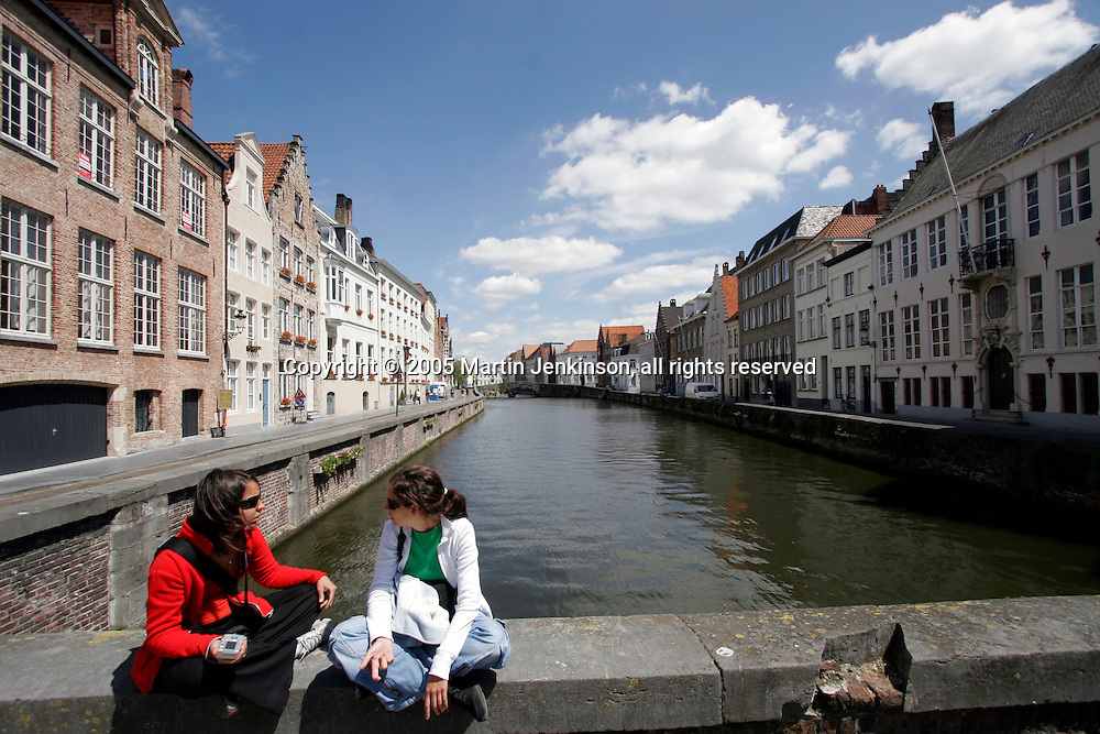 Young female tourists chat by the canal in Brugges ..., Travel, lifestyle