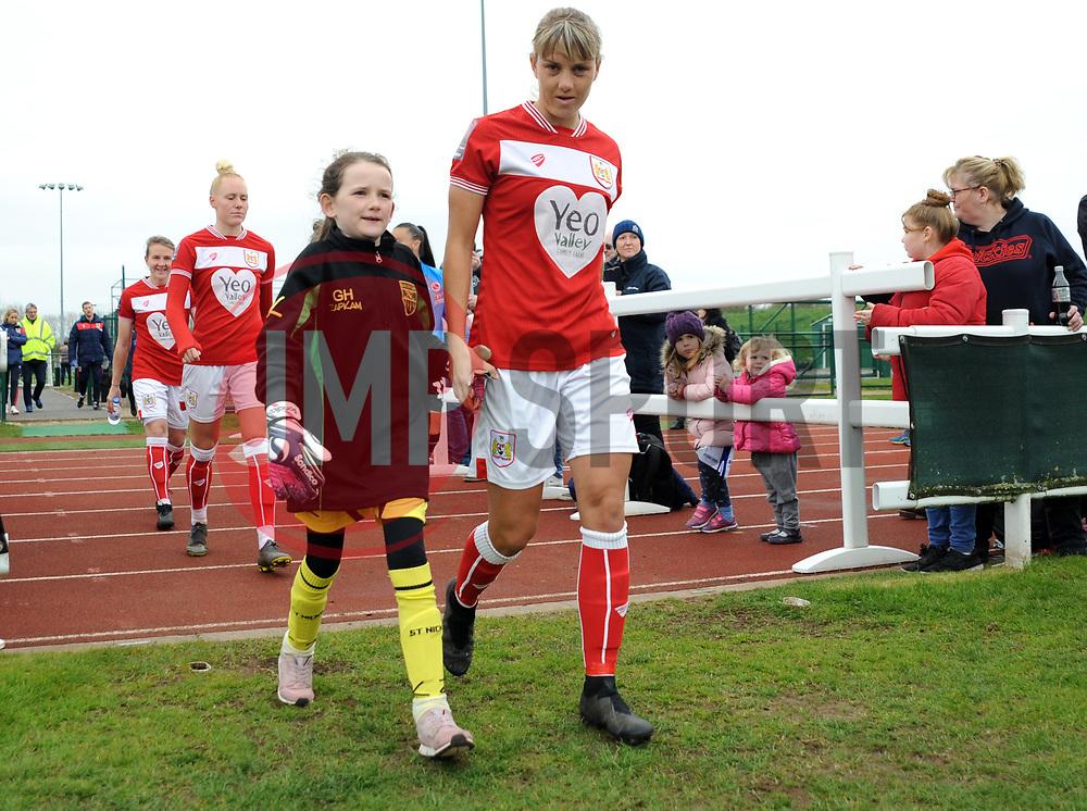 Bristol City Women walk out on the pitch with mascots- Mandatory by-line: Nizaam Jones/JMP- 31/03/2019 - FOOTBALL - Stoke Gifford Stadium - Bristol, England - Bristol City Women v Reading Women - FA Women's Super League 1