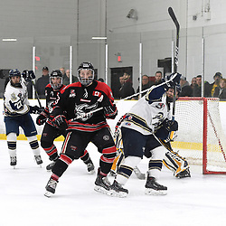 TORONTO, ON  - APR 10,  2018: Ontario Junior Hockey League, South West Conference Championship Series. Game seven of the best of seven series between Georgetown Raiders and the Toronto Patriots. Andrew Court #88 of the Georgetown Raiders battles for position with Dante Spagnuolo #15 of the Toronto Patriots during the third period.<br /> (Photo by Andy Corneau / OJHL Images)