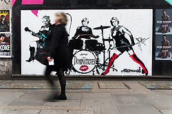 April 17, 2018 - London, United Kingdom - Pedestrians walk past a satirical piece by artist 'Loretto', featuring Queen Elizabeth II, German Chancellor Angela Merkel and British Prime Minister Theresa May, London on April 17, 2018  (Credit Image: © Alberto Pezzali/NurPhoto via ZUMA Press)