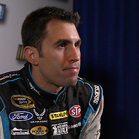 Driver Aric Almirola speaks with the media during the NASCAR Media Day event at Daytona International Speedway on Thursday, February 14, 2013 in Daytona Beach, Florida.  (AP Photo/Alex Menendez)