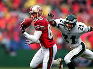 Jerry Rice, third quarter makes a catch of 32 yds that took the 49ers to the 3 yard line and set up their second touchdown also by Rice. Picture taken 12/29/96 at 3Com Park in San Fransisco against the Eagles.
