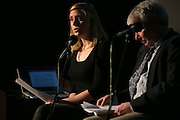 Veronica Volk of WXXI News and Gary Craig of the Democrat & Chronicle speak during the recording of the final episode of Finding Tammy Jo at The Little Theatre in Rochester on Monday, June 13, 2016.