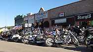 STURGIS, SOUTH DAKOTA - AUGUST 2010:  Motorcyclists gather on Main Street in downtown Sturgis, South Dakota to attend the 70th annual Sturgis Motorcycle Rally held in the Black Hills.  The attendance estimates were placed between 500, 000 and 700,000 bikers.