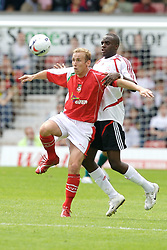 Wrexham, Wales - Saturday, July 7, 2007: Liverpool's Momo Sissoko and Wrexham's Neil Roberts in action against Wrexham during a preseason match at the Racecourse Ground. (Photo by David Rawcliffe/Propaganda)