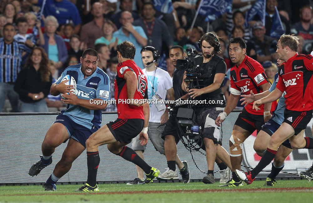 Charlie Faumuina runs with the ball during the Super 15 match, Blues v Crusaders at Eden Park, Auckland, New Zealand. Investec Super 15 Rugby Union. Saturday 19 February 2011. Photo: Andrew Cornaga/PHOTOSPORT