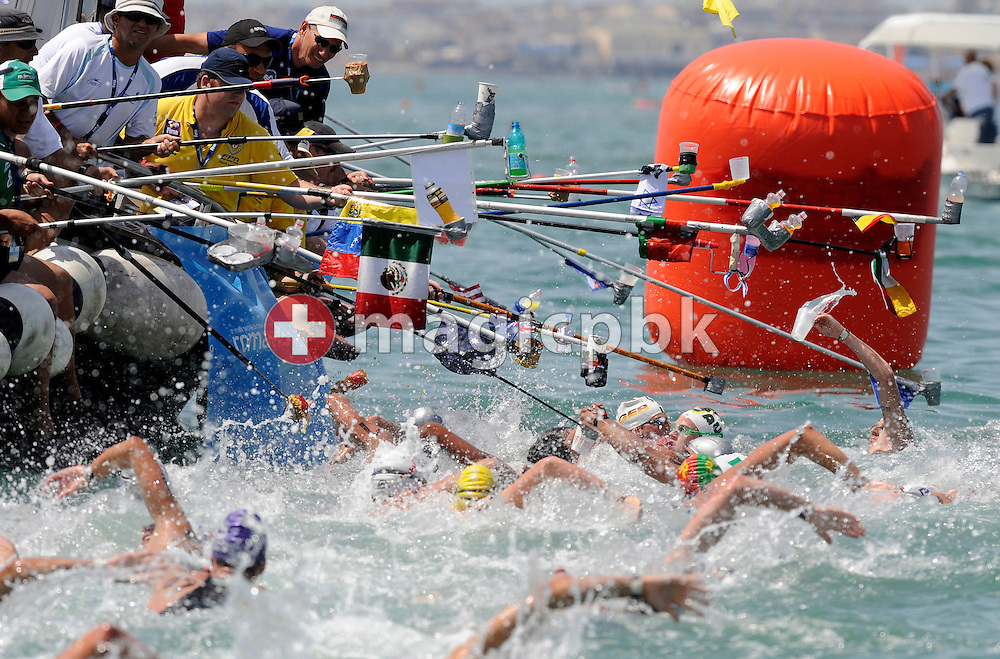 Competitors pass the feeding boat in the men's 10km open water swimming at the 13th FINA World Championships at the beach in Ostia near Rome, Italy, Wednesday, July 22, 2009. (Photo by Patrick B. Kraemer / MAGICPBK)