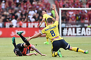 February 12, 2017: Western Sydney Wanderers defender Jack CLISBY (3) cops a push in the back from Central Coast Mariners midfielder Nick MONTGOMERY (captain) (8) at Round 19 of the 2017 Hyundai A-League match, between Western Sydney Wanderers and Central Coast Mariners played at Spotless Stadium in Sydney.