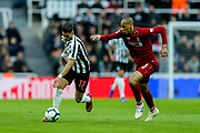 Ayoze Perez (#17) of Newcastle United on the ball pursued by Fabinho (#3) of Liverpool during the Premier League match between Newcastle United and Liverpool at St. James's Park, Newcastle, England on 4 May 2019.