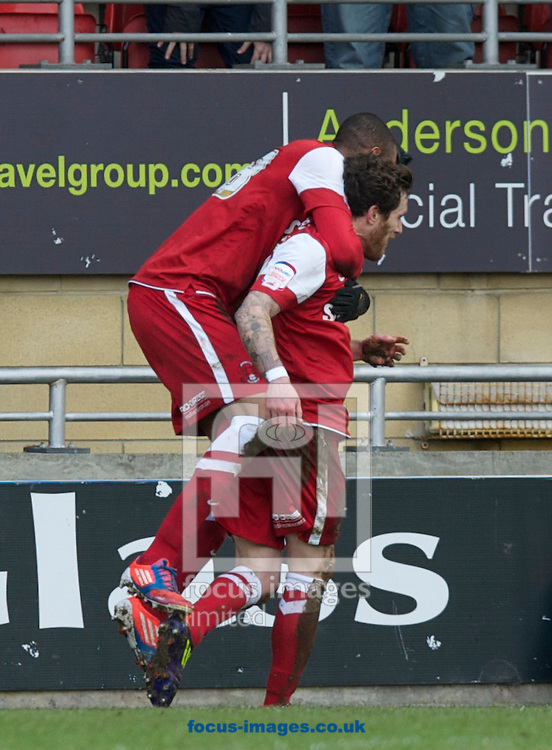 Picture by Alan Stanford/Focus Images Ltd +44 7915 056117.16/03/2013.Romain Vincelot of Leyton Orient is jumped on by team mate Shaun Batt after scoring the 1st goal  during the npower League 1 match at the Matchroom Stadium, London..