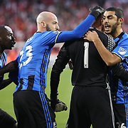 HARRISON, NEW JERSEY- November 06:  Evan Bush #1 of Montreal Impact is congratulated by team mates after saving a penalty kick from Sacha Kljestan #16 of New York Red Bulls during the New York Red Bulls Vs Montreal Impact MLS playoff match at Red Bull Arena, Harrison, New Jersey on November 06, 2016 in Harrison, New Jersey. (Photo by Tim Clayton/Corbis via Getty Images)