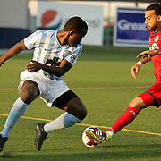 Wilmington Hammerheads FC's Albert Edward challenges Toronto FC's Dwayne De Rosario Wednesday June 18, 2014 at Legion Stadium in Wilmington, N.C. (Jason A. Frizzelle)