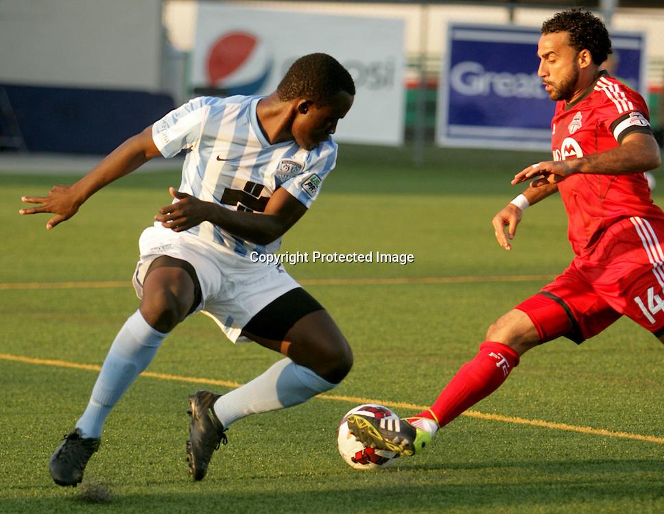 Wilmington Hammerheads FC's Albert Edward challenges Toronto FC's Dwayne De Rosario Wednesday June 18, 2014 at Legion Stadium in Wilmington, N.C. (Jason A. Frizzelle)
