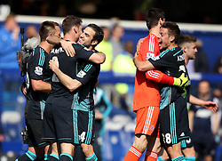 Chelsea's Cesc Fabregas celebrates with Chelsea's Branislav Ivanovic and Chelsea's Cesar Azpilicueta celebrates with Chelsea's Thibaut Courtois  - Photo mandatory by-line: Robbie Stephenson/JMP - Mobile: 07966 386802 - 12/04/2015 - SPORT - Football - London - Loftus Road - Queens Park Rangers v Chelsea - Barclays Premier League