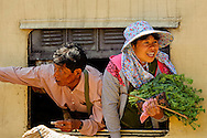 A couple of Burmese expressing joy through a train window, Kalaw, Myanmar