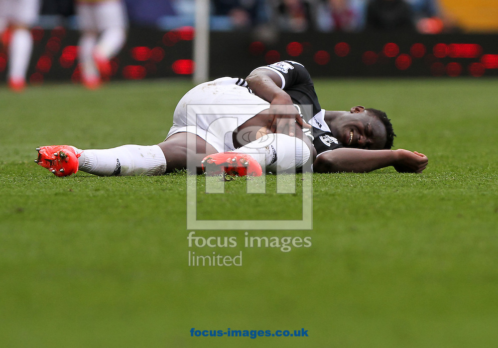 Victor Wanyama of Southampton lies injured during the Barclays Premier League match at Villa Park, Birmingham<br /> Picture by Tom Smith/Focus Images Ltd 07545141164<br /> 19/04/2014