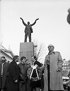 Workers Party Commemoration Of James Larkin.(R50)..1987..07.02.1987..02.07.1987..7th February 1987..A wreath laying ceremony was held today at the memorial for Trade Union leader,James Larkin. The ceremony was conducted the Workers' Party. Mr Tomás McGiolla, leader of the Workers'Party, laid the wreath at the memorial in O'Connell Street, Dublin. The ceremony was held to commomerate the 40th anniversary of the death of James Larkin...Image shows Mr McGiolla holding wreath at the monument in O'Connell Street. Include in the photograph are Clrs, E Byrne, Eamon Gilmore, Mike Jennings and Pat Rabitte.To the left of the group is Prionsíos De Rossa.
