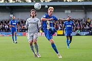 AFC Wimbledon midfielder Mitchell (Mitch) Pinnock (11) battles for possession with Portsmouth midfielder Ryan Williams (7) during the EFL Sky Bet League 1 match between AFC Wimbledon and Portsmouth at the Cherry Red Records Stadium, Kingston, England on 19 October 2019.