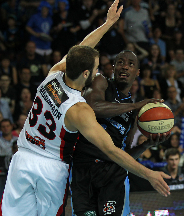 Breakers' Cedric Jackson is challenged by Wildcats' Drew Williamson in the 3rd and deciding grand final match of the ANBL Basketball Championship, Vector Arena, Auckland, New Zealand, Tuesday, April 24, 2012.  Credit:SNPA / David Rowland