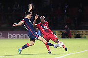 Doncaster Rovers midfielder Harry Middleton  tries to cut out the ball from York City midfielder Anthony Straker  during the Johnstone's Paint Trophy match between York City and Doncaster Rovers at Bootham Crescent, York, England on 6 October 2015. Photo by Simon Davies.
