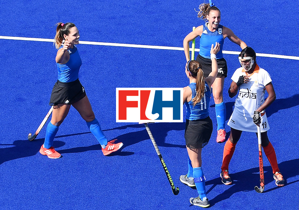 Argentina's Carla Rebecchi celebrates scoring with her team-mates during the women's field hockey Argentina vs India match of the Rio 2016 Olympics Games at the Olympic Hockey Centre in Rio de Janeiro on August, 13 2016. / AFP / MANAN VATSYAYANA        (Photo credit should read MANAN VATSYAYANA/AFP/Getty Images)