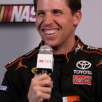 Driver Denny Hamlin speaks with the media during the NASCAR Media Day event at Daytona International Speedway on Thursday, February 14, 2013 in Daytona Beach, Florida.  (AP Photo/Alex Menendez)