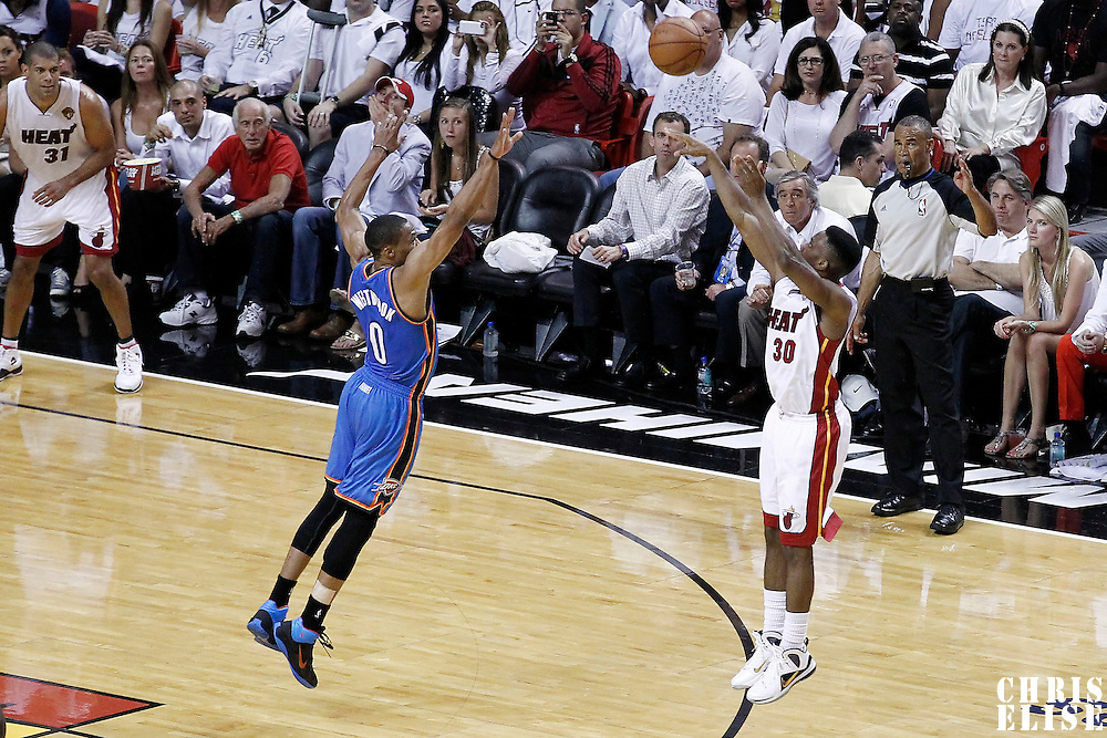 21 June 2012: Miami Heat point guard Norris Cole (30) takes a three point jumpshot over Oklahoma City Thunder point guard Russell Westbrook (0) during the Miami Heat 121-106 victory over the Oklahoma City Thunder, in Game 5 of the 2012 NBA Finals, at the AmericanAirlinesArena, Miami, Florida, USA. The Miami Heat wins the series 4-1.