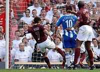 Photo: Daniel Hambury.<br />Arsenal v Wigan Athletic. The Barclays Premiership. 07/05/2006.<br />Arsenal's Robert Pires scores to make it 1-0.