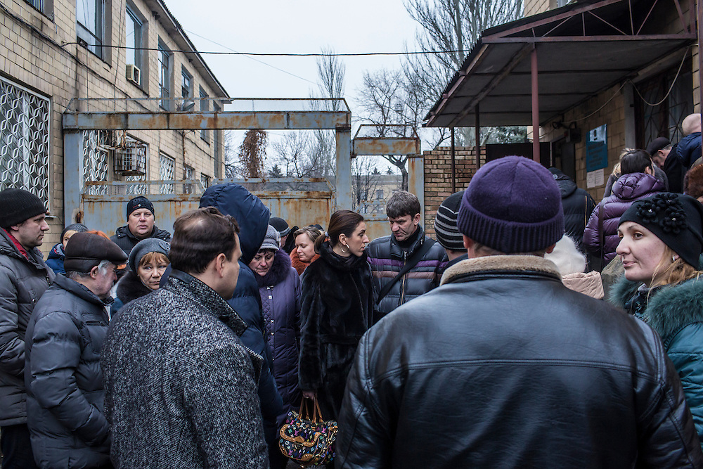 VELYKA NOVOSILKA, UKRAINE - JANUARY 22, 2015: People wait outside a police station to obtain permission to enter the rebel-controlled city of Donetsk in Velyka Novosilka, Ukraine. The process takes ten days and requires a written explanation of the purpose of one's travel. CREDIT: Brendan Hoffman for The New York Times