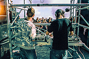 DJs playing to ravers in scaffolding, Trefyl Quarry, Wales, July 2008