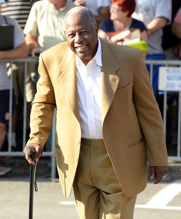 COOPERSTOWN, NY - JULY 26: Hall of Famer Hank Aaron participates in the annual Parade of Legends down Main Street in Cooperstown, New York on July 26, 2014.