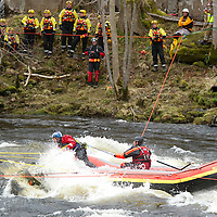 Canoeist Dies in River Tay Tradegy at Grandtully, Perthshire....08.04.10<br /> Rescue specialists battle against the raging waters of the River Tay to put holes in the canoe in an attempt to free the canoe from the submerged rocks.<br /> Picture by Graeme Hart.<br /> Copyright Perthshire Picture Agency<br /> Tel: 01738 623350  Mobile: 07990 594431